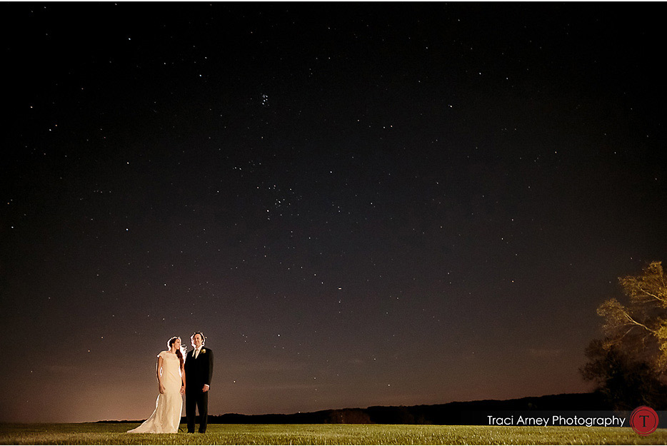 Couple standing on grass with a starry dusk sky at Willow Oaks Plantation in Eden, NC