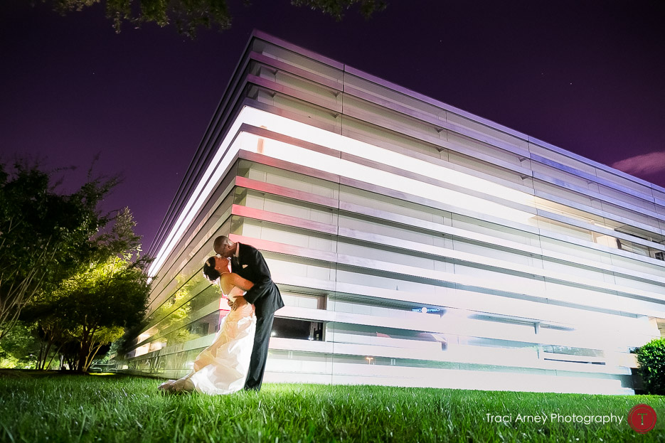 cool architectural lines behind couple in colorful romance session in Uptown Charlotte