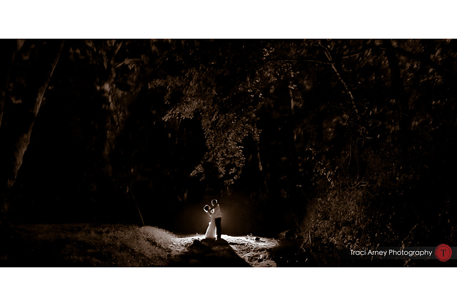 Bride and groom in creek backlit during romance session in Winston-Salem, NC