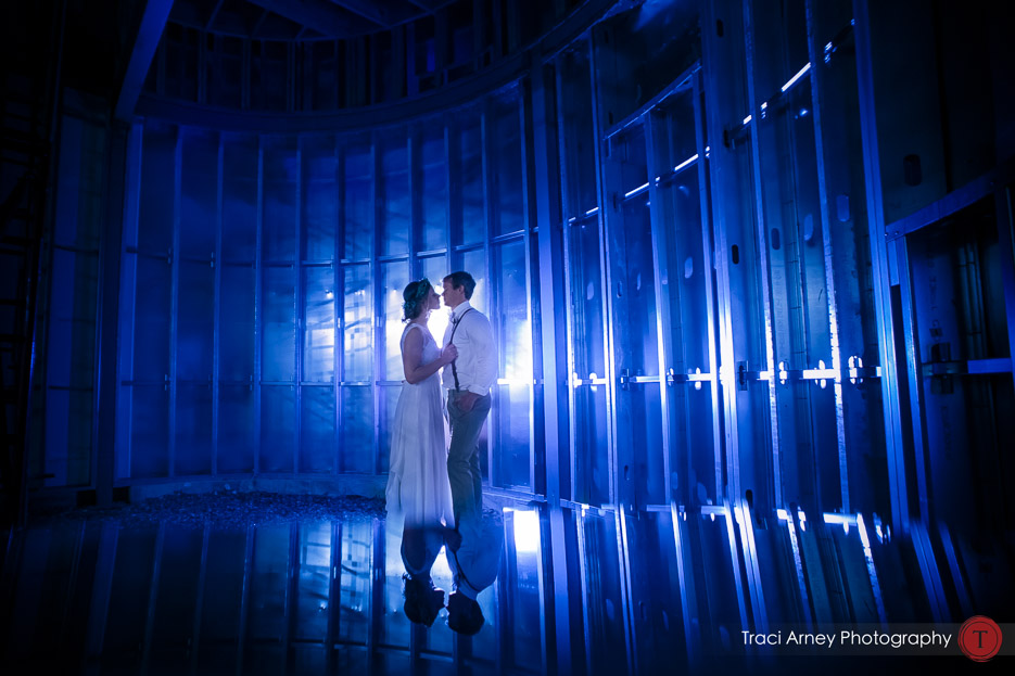 Bride and groom in blue lit silo during their romance from their outdoor wedding at Summerfield Farms, Summerfield, NC