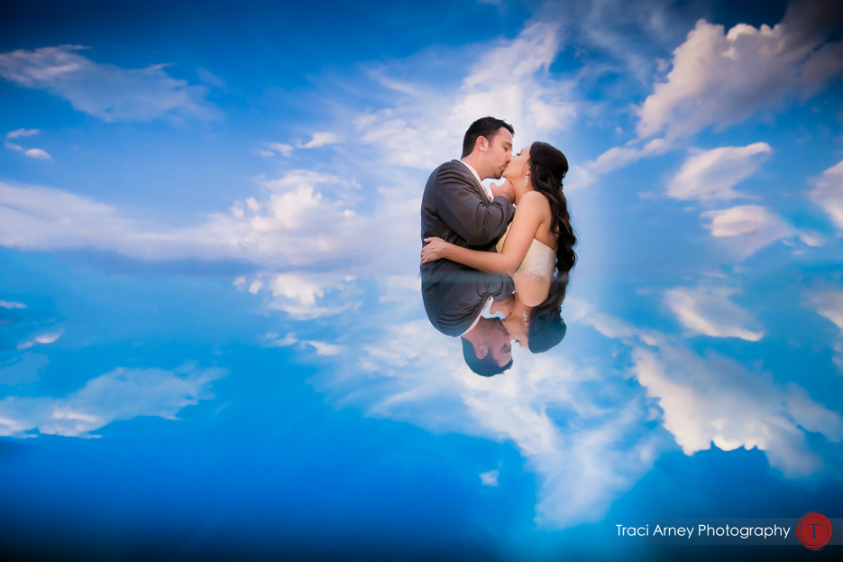 bride and groom surrounded by clouds and blue sky at Grandover Resort wedding in Greensboro, NC.